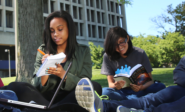 Students on campus studying