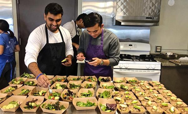 Students in kitchen preparing food